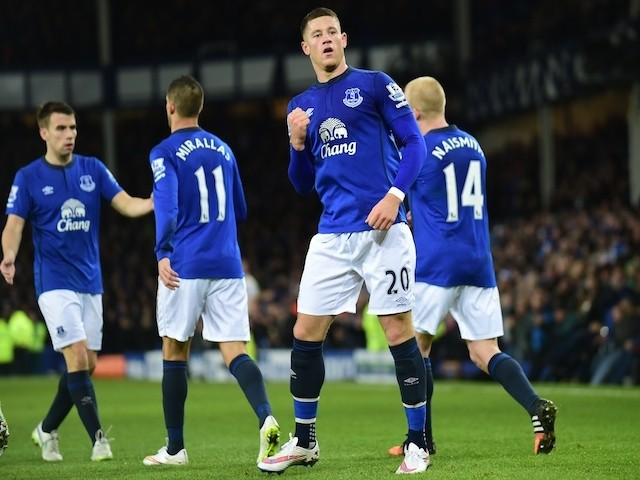 Everton's English midfielder Ross Barkley (C) celebrates scoring the opening goal during the English Premier League football match against Queens Park Rangers on December 15, 2014