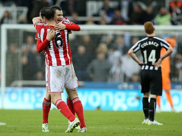 Sunderland's Irish defender John O'Shea celebrates at the final whistle with goal-scorer, Sunderland's English midfielder Adam Johnson after the English Premier League football match between Newcastle United and Sunderland at St James' Park in Newcastle-u