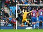 Fraizer Campbell of Crystal Palace performs an overhead kick at goal as Joe Hart of Manchester City comes out to save during the Barclays Premier League match between Manchester City and Crystal Palace at Etihad Stadium on December 20, 2014