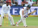Dean Elgar of South Africa plays to mid wicket during day 1 of the 2nd Test match between South Africa and West Indies at St. Georges Park on December 26, 2014