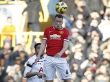 Manchester United's English defender Phil Jones wins a header during the English Premier League football match between Tottenham Hotspur and Manchester United at White Hart Lane in London on December 28, 2014