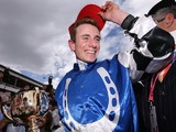 Jockey Ryan Moore celebrates with the trophy after winning on Protectionist in race 7 the Emirates Melbourne Cup on November 4, 2014