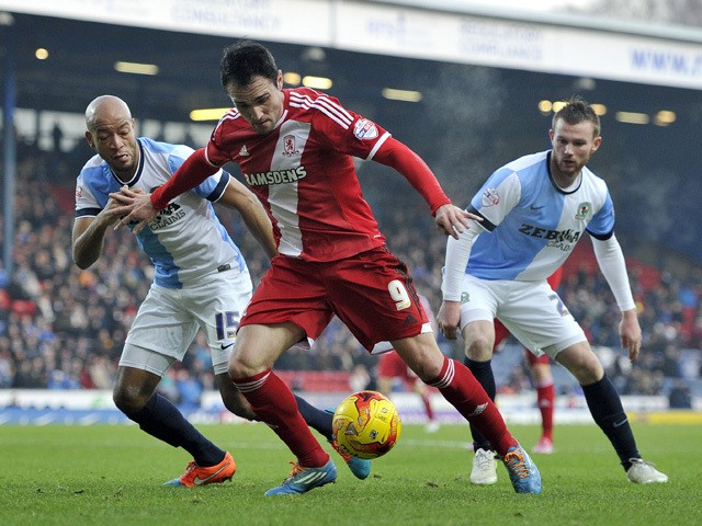 Alex Baptiste of Blackburn Rovers and Kike of Middlesbrough battle for the ball during the Sky Bet Championship match between Blackburn Rovers and Middlesbrough at Ewood Park on December 28, 2014