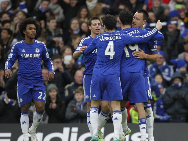 Chelsea's English defender John Terry celebrates scoring the opening goal with teammates during the English Premier League football match between Chelsea and West Ham United at Stamford Bridge in London on December 26, 2014