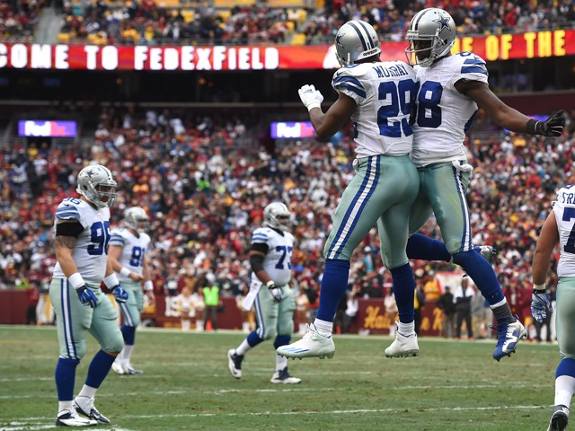 Running back DeMarco Murray #29 of the Dallas Cowboys celebrates with teammate Dez Bryant #88 after scoring a second quarter touchdown against the Washington Redskins at FedExField on December 28, 2014