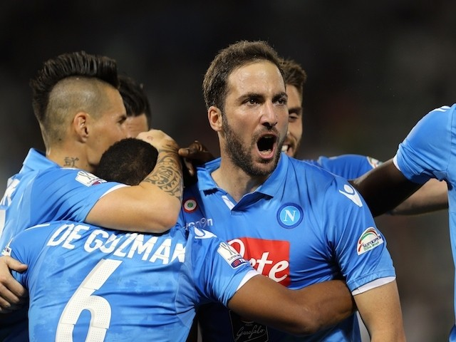 Napoli's Argentine striker Gonzalo Higuain (C) celebrates with teammates after scoring during their Italian Super Cup football match against Juventus on December 22, 2014