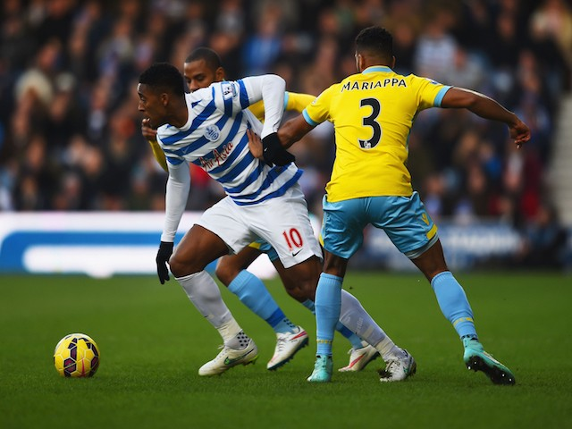 Leroy Fer of QPR evades Adrian Mariappa of Crystal Palace during the Barclays Premier League match on December 28, 2014