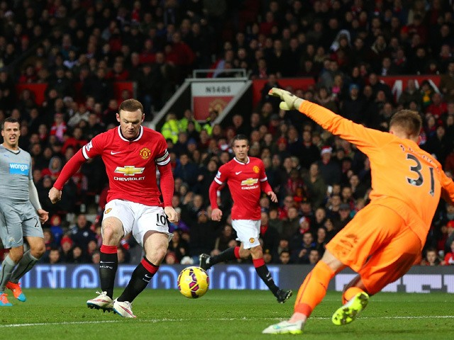Wayne Rooney of Manchester United scores the first goal during the Barclays Premier League match between Manchester United and Newcastle United at Old Trafford on December 26, 2014