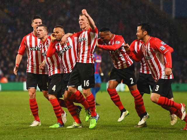 Ryan Bertrand of Southampton celebrates with team mates as he scores their second goal during the Barclays Premier League match between Crystal Palace and Southampton at Selhurst Park on December 26, 2014