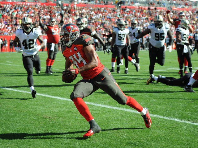 Running back Charles Sims #34 of the Tampa Bay Buccaneers scores a touchdown against the New Orleans Saints in the second quarter at Raymond James Stadium on December 28, 2014