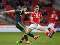 Adam Clayton of Middlesbrough clears the ball from Luke Berry of Barnsley during the FA Cup Third Round match on January 3, 2015