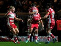 Billy Twelvetress of Gloucester runs to celebrate with Mark Atkinson of Gloucester at the final whistle during the Aviva Premiership match between Exeter Chiefs and Gloucester Rugby at Sandy Park on January 3, 2015