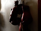 oxing gloves hang on the wall at the Urbina Westside Boxing Gym where Israel Vasquez Two-time Junior Featherweight World Champion had a workout session on September 29, 2009 i