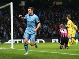 James Milner of Manchester City celebrates after scoring a goal to level the scores at 1-1 during the FA Cup Third Round match between Manchester City and Sheffield Wednesday at Etihad Stadium on