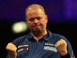 Raymond van Barneveld of the Netherlands celebrates winning a set during his quarter final match against Stephen Bunting on January 2, 2015