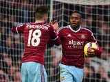 Diafra Sakho of West Ham United celebrates with Carl Jenkinson as he scores their first goal during the Barclays Premier League match between West Ham United and West Bromwich Albion at Boleyn Ground on January 1, 2015