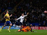 Zach Clough (C) of Bolton scores the opening goal during the FA Cup Third Round match between Bolton Wanderers and Wigan Athletic at the Macron Stadium on January 3, 2015