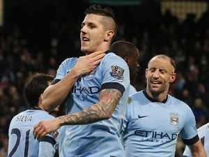 Manchester City's Montenegrin striker Stevan Jovetic celebrates scoring their second goal during the English Premier League football match between Manchester City and Sunderland at the Etihad Stadium in Manchester, north west England, on January 1, 2015