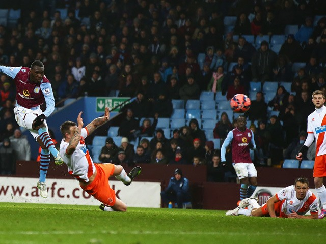 Christian Benteke of Aston Villa scores the opening goal during the FA Cup Third Round match between Aston Villa and Blackpool at Villa Park on January 4, 2015