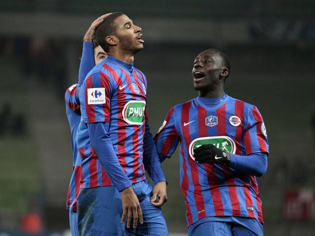 Caen's French midfielder Jordan Adeoti celebrates with teammates after scoring during the French Cup round of 64 football match between Caen and Dijon at the Michel d'Ornano stadium in Caen, northwestern France, on January 4, 2015