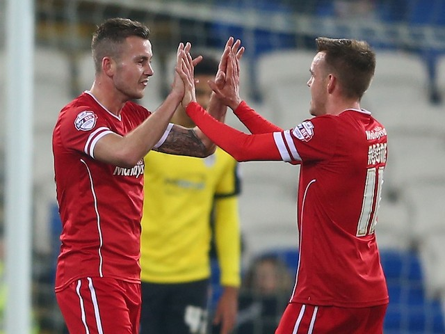 Joe Ralls (C) of Cardiff celebrates with Craig Noone (R) after scoring the opening goal during the FA Cup Third Round match against Colchester United on December 2, 2014