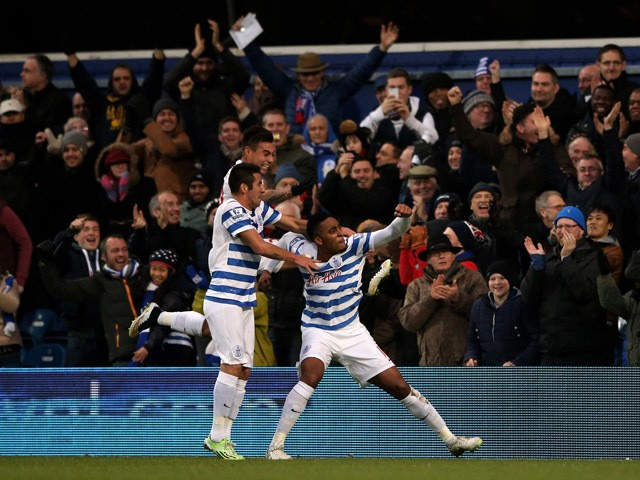 Leroy Fer of QPR celebrates with teammates after scoring the opening goal during the Barclays Premier League match between Queens Park Rangers and Swansea City at Loftus Road on January 1, 2015