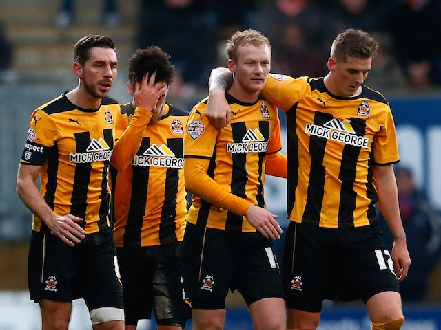 Robbie Simpson of Cambridge is congratulated by team mates after scoring to make it 1-0 during the FA Cup Third Round match between Cambridge United and Luton on January 3, 2015
