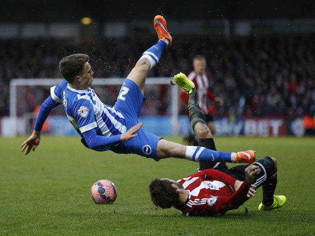 Solly March of Brighton & Hove Albion is tackled by Tommy Smith of Brentford during the FA Cup Third Round match on January 3, 2015