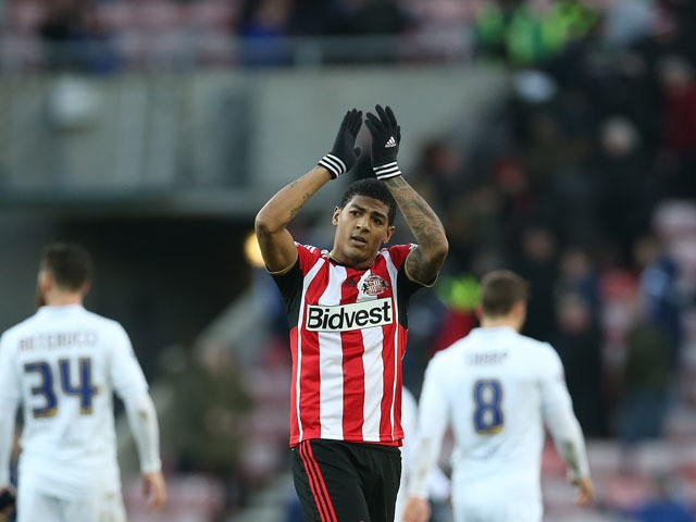 Sunderland's Dutch defender Patrick van Aanholt applauds supporters at the final whistle in the English FA Cup third round football match between Sunderland and Leeds United at Stadium of Light in Sunderland, north east England on January 4, 2015