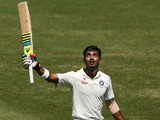 Lokesh Rahul of India celebrates and acknowledges the crowd after scoring a century during day three of the Fourth Test match against Australia on January 8, 2015