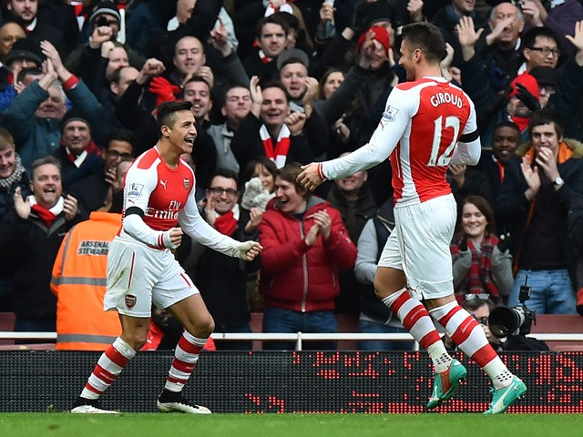 Arsenal's Chilean striker Alexis Sanchez celebrates with Arsenal's French striker Olivier Giroud after scoring their second goal during the English Premier League football match between Arsenal and Stoke City at the Emirates Stadium in London on January 1