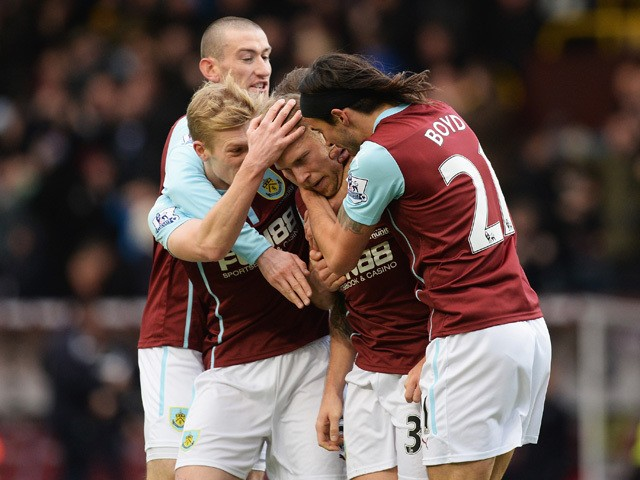 Scott Arfield of Burnley celebrates scoring the opening goal with team mates during the Barclays Premier League match between Burnley and Queens Park Rangers at Turf Moor on January 10, 2015