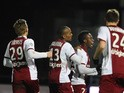 Metz' players celebrate after scoring during the French L1 football match Metz vs Montpellier on January 17, 2015