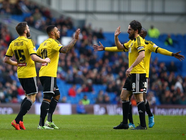 Andre Gray of Brentford celebrates with team mates after scoring the first goal of the game during the Sky Bet Championship match between Brighton & Hove Albion and Brentford at The Amex Stadium on January 17, 2015