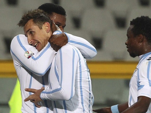 Miroslav Klose #11 of SS Lazio celebrates with his team-mate Balte Keita after scoring his goal during the TIM Cup match between Torino FC and SS Lazio at Stadio Olimpico di Torino on January 14, 2015