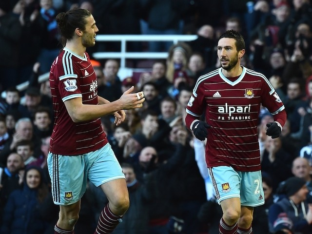 West Ham United's Morgan Amalfitano (R) celebrates scoring their second goal with Andy Carroll (L) during the English Premier League match against Hull City on January 18, 2015
