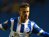 Joe Bennett of Brighton is challenged by Roger Espinoza of Wigan during the Sky Bet Championship match against Wigan Athletic on November 4, 2014