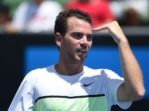 Adrian Mannarino in action on day four of the Australian Open on January 22, 2015