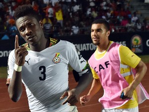 Ghana's forward Asamoah Gyan celebrates with teammate Kwesi Appiah after scoring a goal during the 2015 African Cup of Nations group C football match between Ghana and Algeria in Mongomo on January 23, 2015