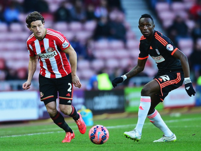 Billy Jones of Sunderland is closed down by Seko Fofana of Fulham during the FA Cup Fourth Round match between Sunderland and Fulham at Stadium of Light on January 24, 2015