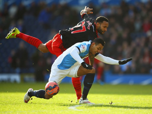 Kyle Bartley of Swansea City tangles with Joshua King of Blackburn Rovers during the FA Cup Fourth Round match between Blackburn Rovers and Swansea City at Ewood park on January 24, 2015