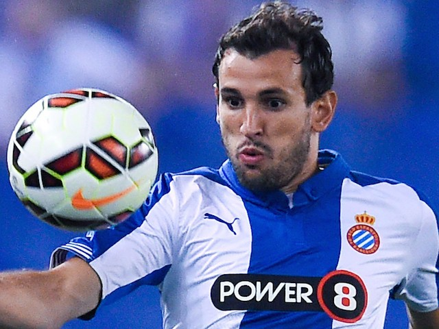 Christian Stuani of RCD Espanyol runs with the ball during the La Liga Match between RCD Espanyol and Sevilla FC at Cornella-El Prat Stadium on August 30, 2014