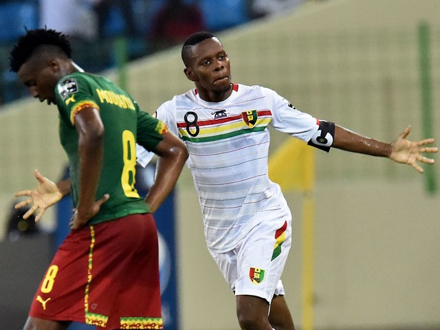Guinea's midfielder Ibrahima Traore celebrates after scoring a goal during the 2015 African Cup of Nations group D football match between Cameroon and Guinea in Malabo on January 24, 2015