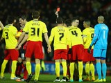 Referee Lee Probert shows Gabriele Angella of Watford (#4) a red card during the Sky Bet Championship match against Bournemouth on January 30, 2015