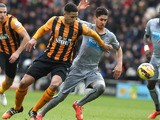 Hull City's English defender Curtis Davies challenges Newcastle United's Spanish striker Ayoze Perez during the English Premier League football match between Hull City and Newcastle United at the KC Stadium in Hull, Northern England, on January 31, 2015