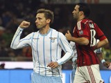 Lucas Biglia of SS Lazio celebrates after scoring the opening goal during the Serie A match between AC Milan and SS Lazio at Stadio Giuseppe Meazza on January 27, 2015