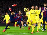 Luis Suarez of FC Barcelona performs an overhead during the La Liga match between FC Barcelona and Villarreal CF at Camp Nou on February 1, 2015