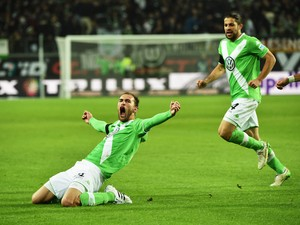 Bas Dost of Wolfsburg celebrate scoring his second goal during the Bundesliga match between VfL Wolfsburg and FC Bayern Muenchen at Volkswagen Arena on January 30, 2015