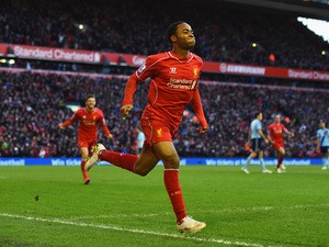 Raheem Sterling of Liverpool celebrates scoring the opening goal during the Barclays Premier League match between Liverpool and West Ham United at Anfield on January 31, 2015
