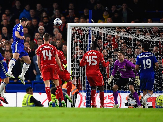 Branislav Ivanovic of Chelsea heads in their first goal in extra time during the Capital One Cup Semi-Final second leg against Liverpool on January 27, 2015